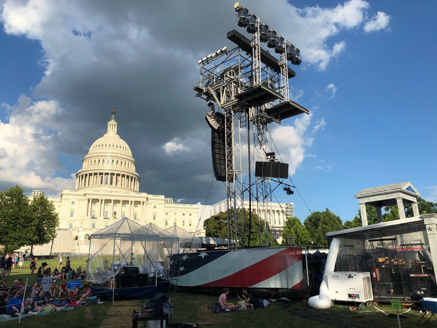 "Music wafted through the steamy air near the U.S. Capitol Wednesday as rehearsals were held for Independence Day's ""A Capitol Fourth"" concert on the West Lawn. (WTOP/Michelle Basch)"