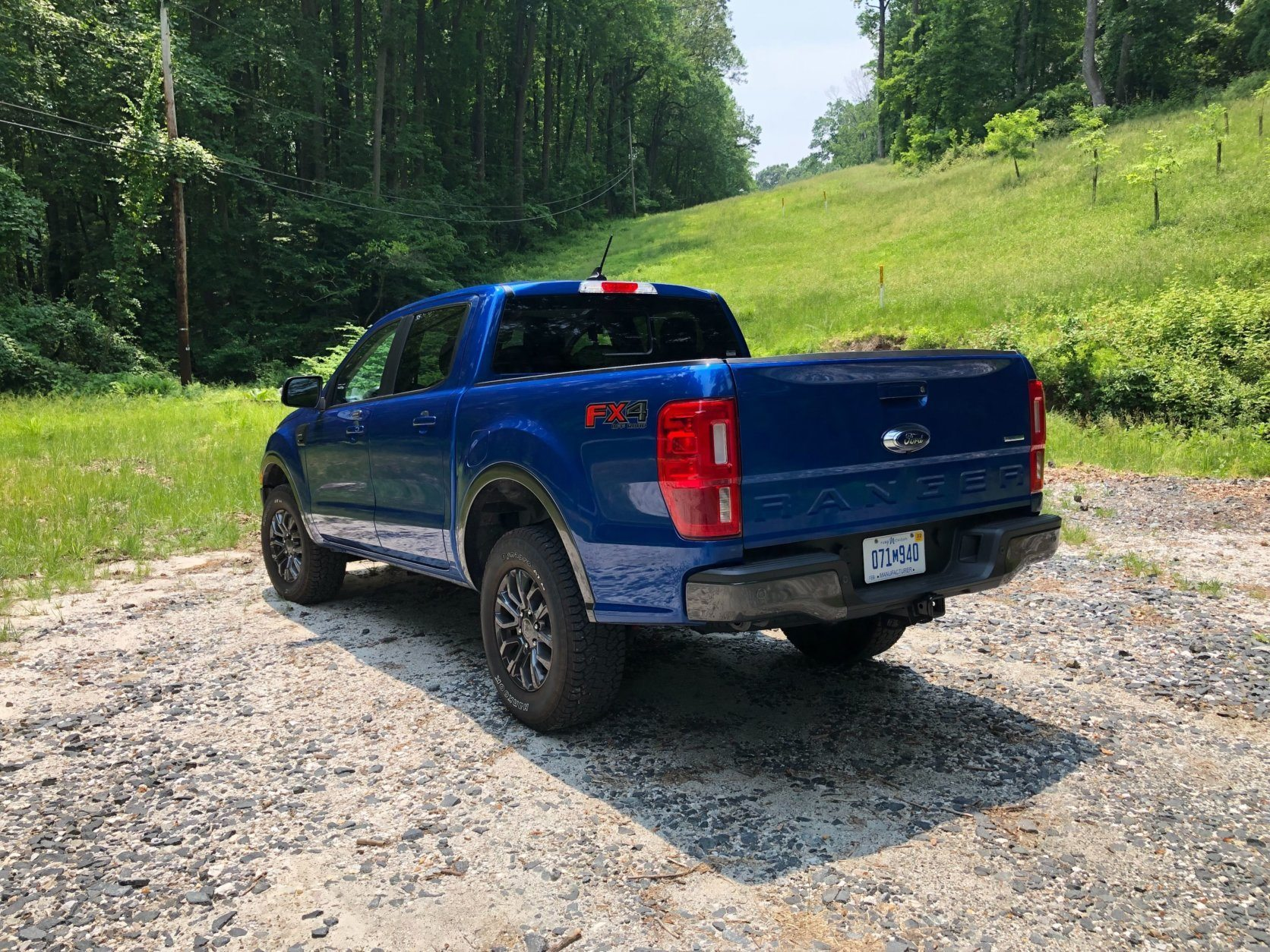 <p>This is a truck, so don't expect sport car handling. There is plenty of body lean. The Ranger navigates better than a larger truck around town with a smaller and less bulky stance. It's not as wide as an F-150 so it's easier to fit in smaller spaces and park.</p>