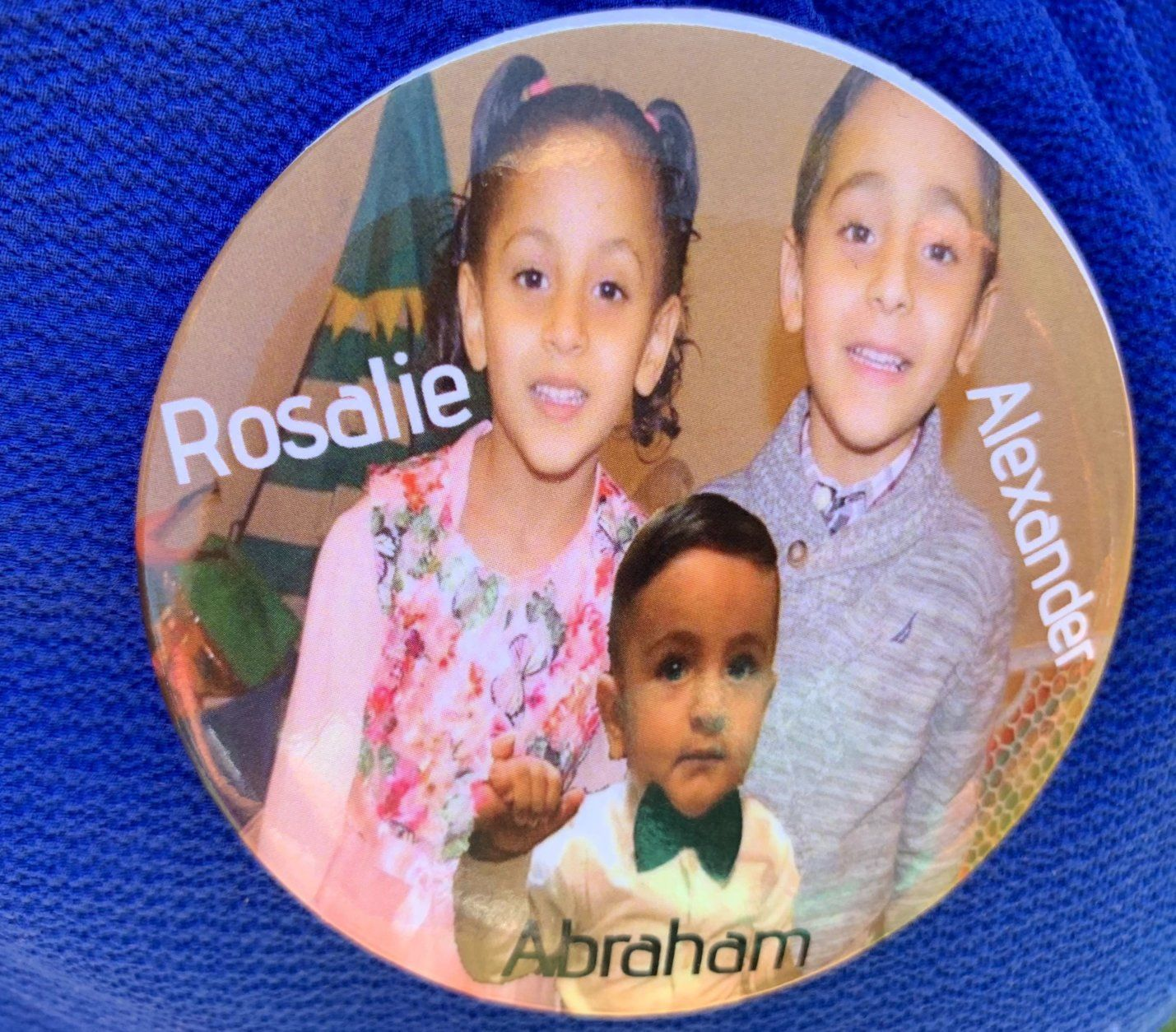Dozens of family members and friends showed up to support the couple, many wearing buttons that had the names and faces of the three children. (WTOP/Mike Murillo)