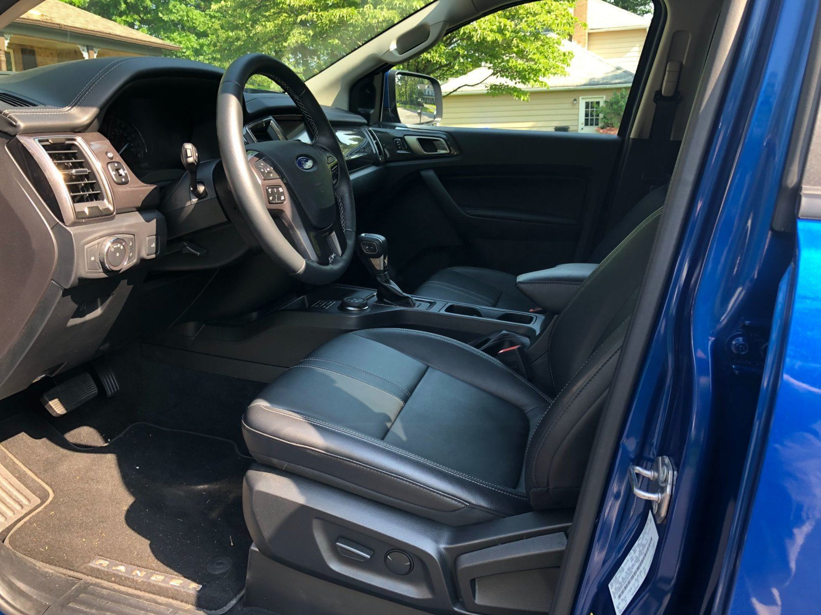 <p>The inside of the 2019 Ranger Lariat is a comfortable place. Heated leather power seats up front, leather steering wheel and console-mounted shifter have the look and feel buyers of a nearly $45,000 truck expect. There are still some hard plastics in the cabin, although a bit less than the competition. Controls are straight forward but some drivers may find some of the buttons a bit small and clustered a too low for their reach.</p>