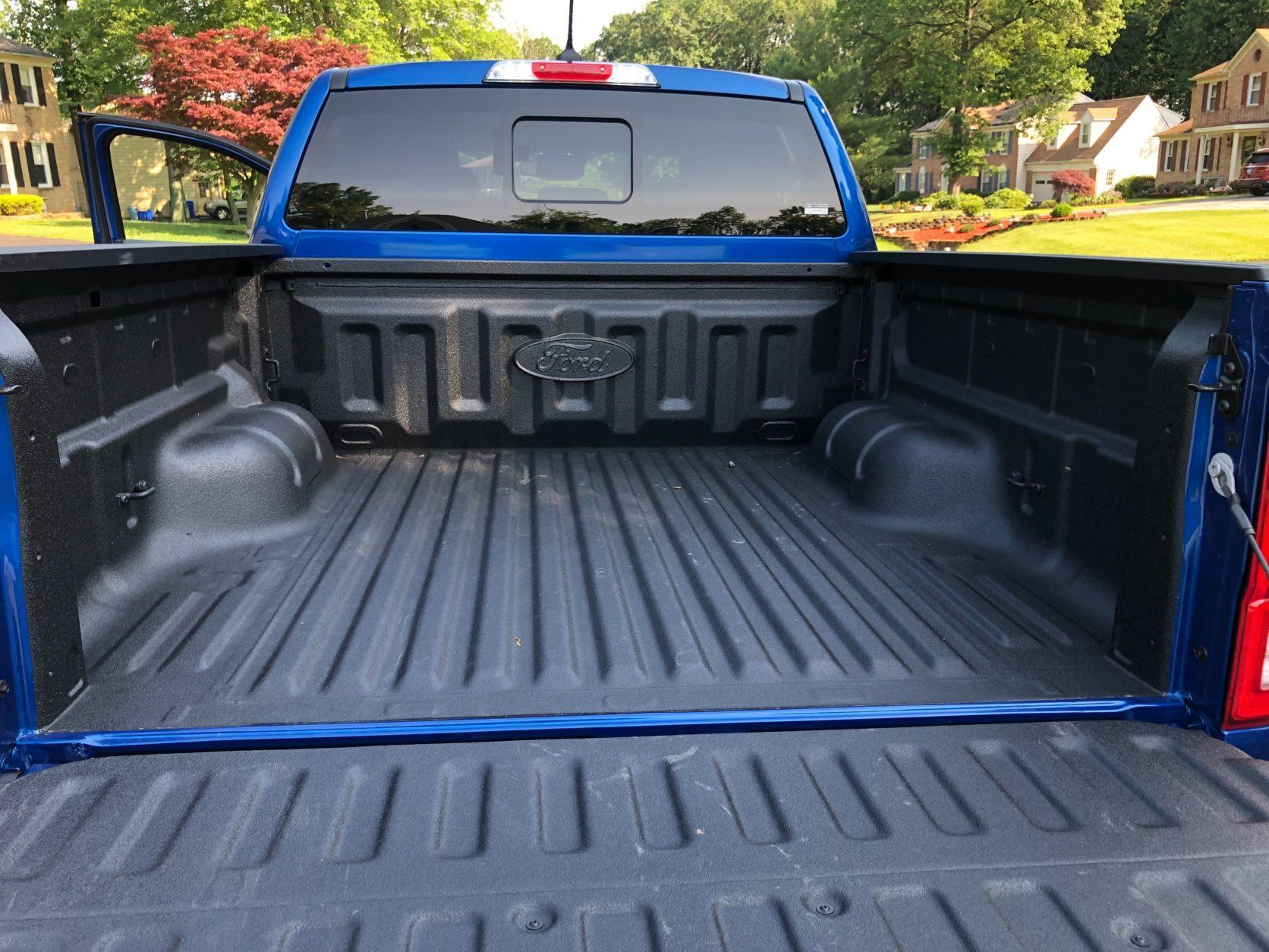 <p>Out back, the optional spray bed liner helps protect the bed and the trailer tow package adds the hitch and hookups for $500 each.</p>