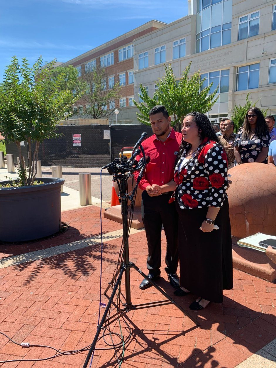 Parents Juanita and Alexis Mejia spoke outside the courthouse on Monday, July 1, 2019. (WTOP/Mike Murillo)