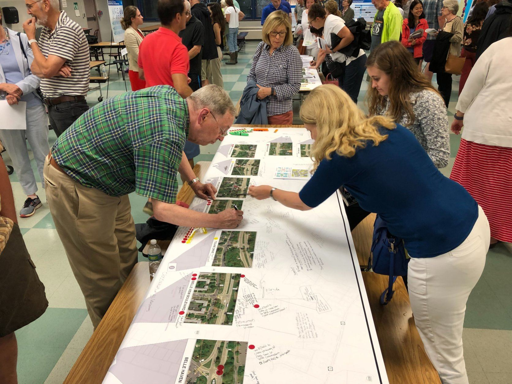 People look at information at GW Parkway meeting