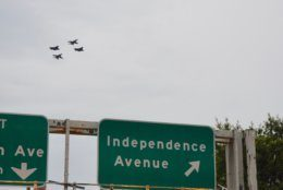 Military planes fly over Independence Avenue in D.C. Thursday evening. (WTOP/Dave Dildine)