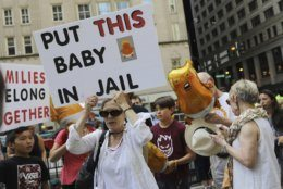 Thousands of people, including immigrants and their supporters, rally against President Trump's immigration policy, especially the detention of children, marching from Daley Plaza to the Chicago field office for Immigration and Customs Enforcement,, Saturday, July 13, 2019 in Chicago. (Abel Uribe/Chicago Tribune via AP)