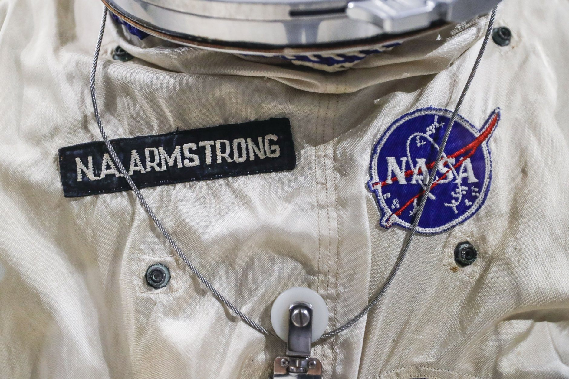 Patches adorn the spacesuit worm by astronaut Neil Armstrong for the Gemini VIII mission at the Armstrong Air & Space Museum, Wednesday, June 26, 2019, in Wapakoneta, Ohio.  Neil Armstrong helped put Wapakoneta  on the map July 20, 1969, when he became the first human to walk on the moon. The late astronaut remains larger than life in the city 60 miles (96.56 kilometers) north of Dayton, where visitors are greeted by the space base-shaped top of the space museum named for him as they exit Interstate 75. (AP Photo/John Minchillo)