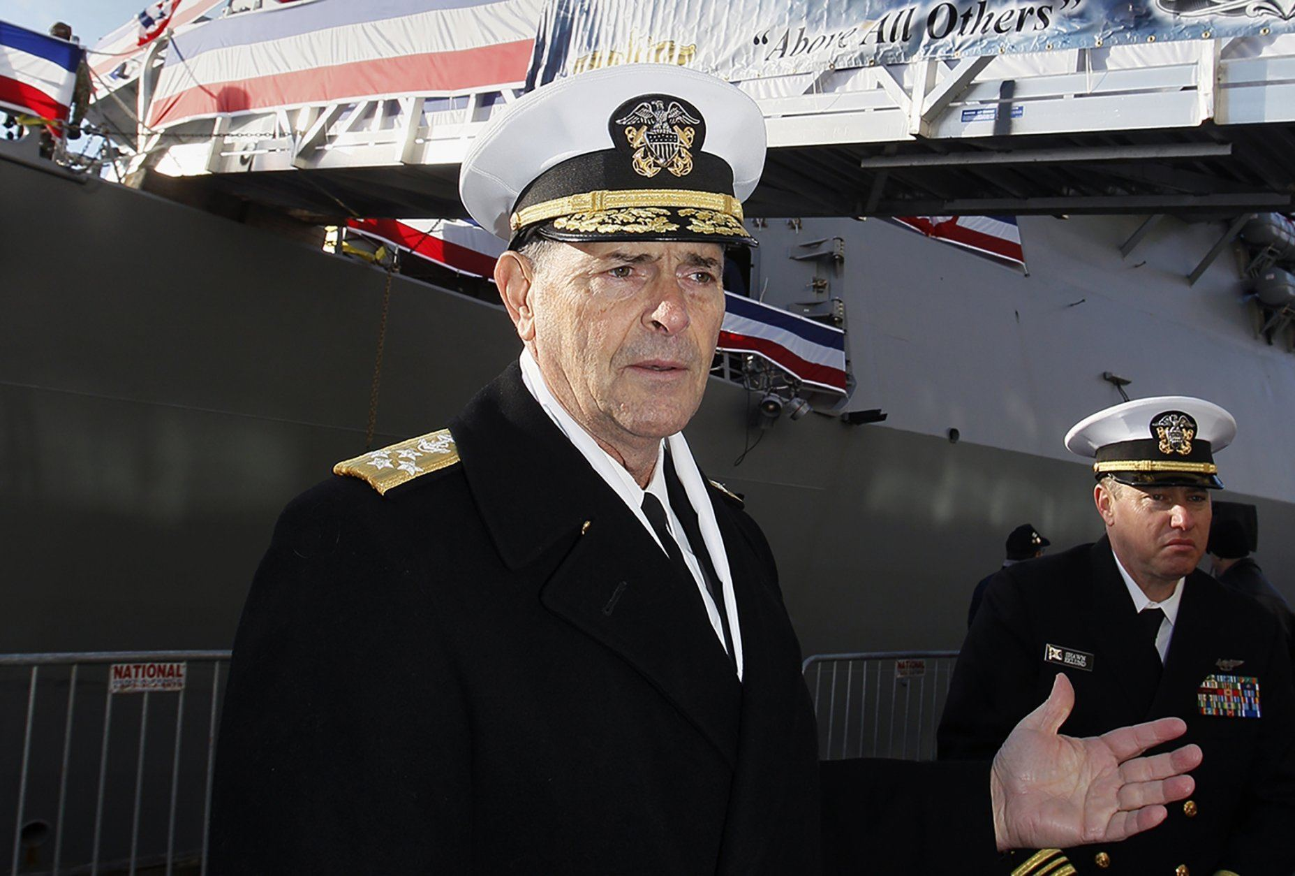"""FILE - In this Dec. 1, 2018 file photo, Vice Chief of Naval Operations, Adm. William Moran describes the function of the USS Thomas Hudner prior to its commissioning ceremony  in Boston.  Moran, the Navy admiral set to become his service's top officer on Aug. 1, 2019, says he will instead retire. The extraordinary downfall of Moran was prompted by what Navy Secretary Richard Spencer on Sunday, July 7 called poor judgment. Spencer faulted Moran for having a professional relationship with a person who had been disciplined for what Spencer called """"failing to meet the values and standards of the naval profession."""" (Paul Connors/The Boston Herald via AP, File)"""