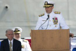 """FILE- In this Sept. 10, 2016, file photo. Adm. William Moran speaks during the Commissioning of the USS Montgomery in Mobile, Ala. Moran, the Navy admiral set to become his service's top officer on Aug. 1, 2019, says he will instead retire. The extraordinary downfall of Moran was prompted by what Navy Secretary Richard Spencer on Sunday, July 7 called poor judgment. Spencer faulted Moran for having a professional relationship with a person who had been disciplined for what Spencer called """"failing to meet the values and standards of the naval profession.""""  (Albert Cesare/Montgomery Advertiser via AP, File)"""