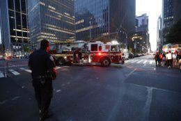 Fire trucks respond during a widespread power outage in the Manhattan borough of New York, Saturday, July 13, 2019, Authorities say a transformer fire caused a power outage in Manhattan and left businesses without electricity, elevators stuck and subway cars stalled. (AP Photo/Michael Owens)