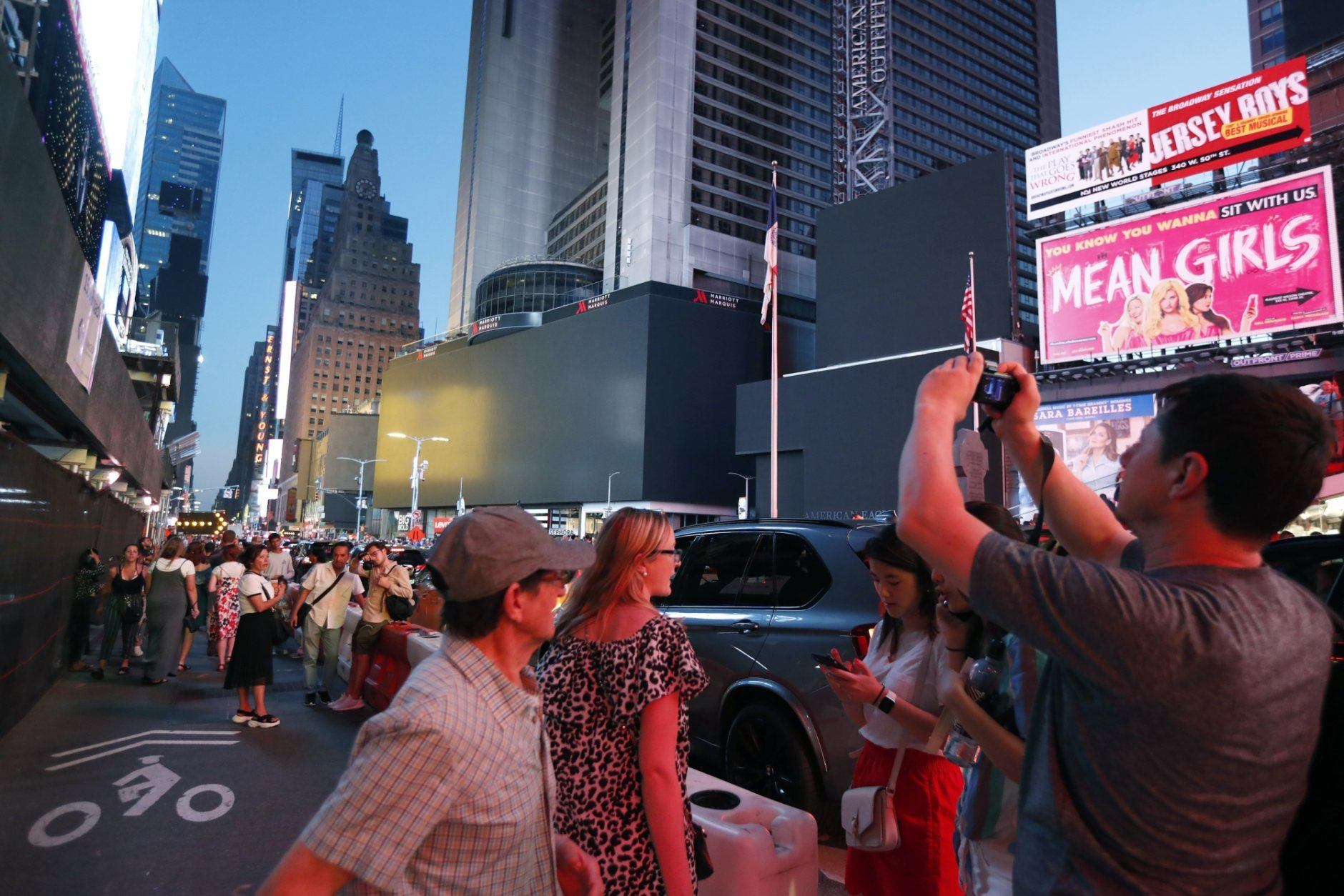 Screens in Times Square are black during a widespread power outage, Saturday, July 13, 2019, in New York. Authorities say a transformer fire caused a power outage in Manhattan and left businesses without electricity, elevators stuck and subway cars stalled.  (AP Photo/Michael Owens)