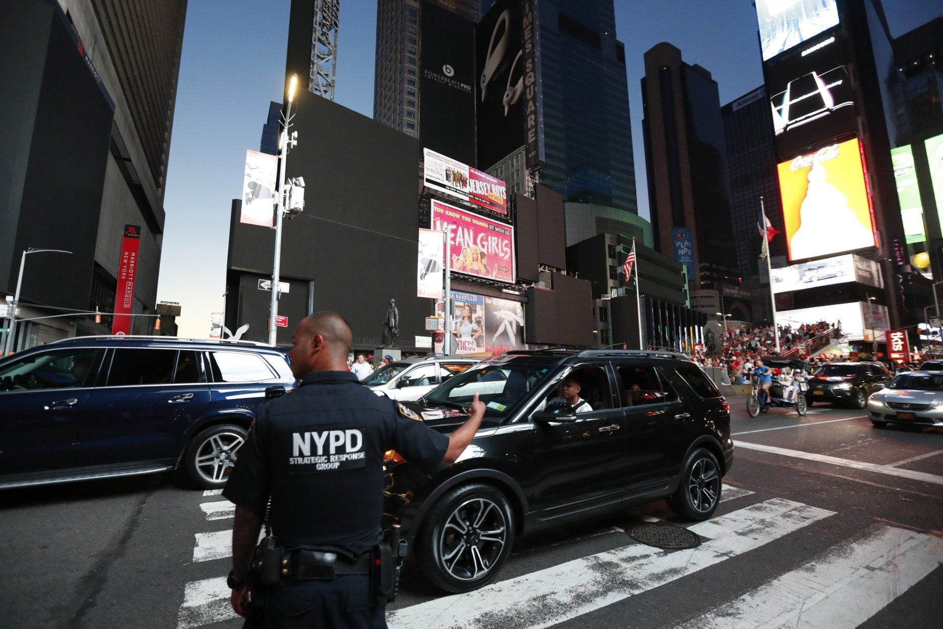 A police officer directs traffic in Times Square during a widespread power outage, Saturday, July 13, 2019, in the Manhattan borough of New York. Authorities say a transformer fire caused a power outage in Manhattan and left businesses without electricity, elevators stuck and subway cars stalled. (AP Photo/Michael Owens)