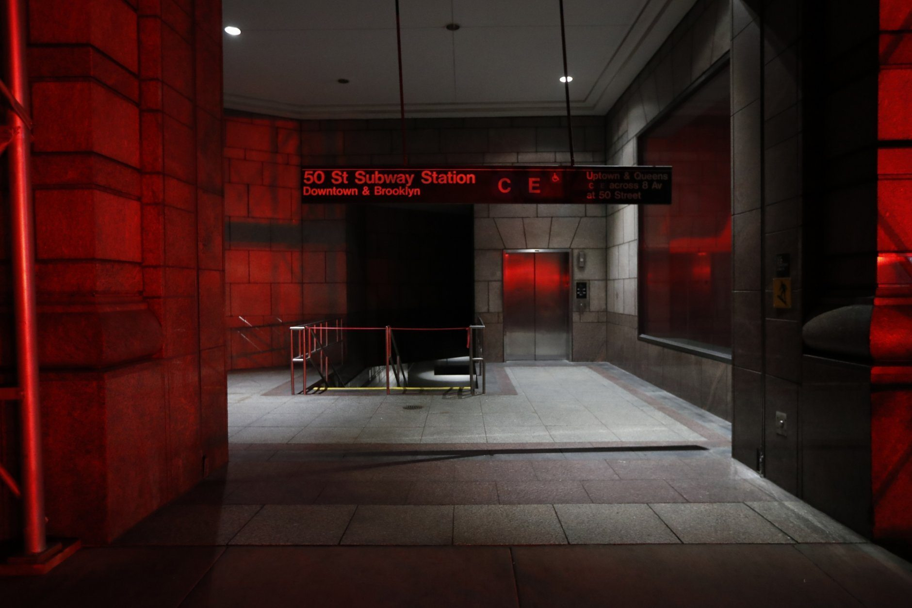 An area leading to the C and E trains at the 50th Street Subway Station is dimly lit during a power outage, Saturday, July 13, 2019, in New York. Authorities were scrambling to restore electricity to Manhattan following a power outage that knocked out Times Square's towering electronic screens and darkened marquees in the theater district and left businesses without electricity, elevators stuck and subway cars stalled. (AP Photo/Michael Owens)
