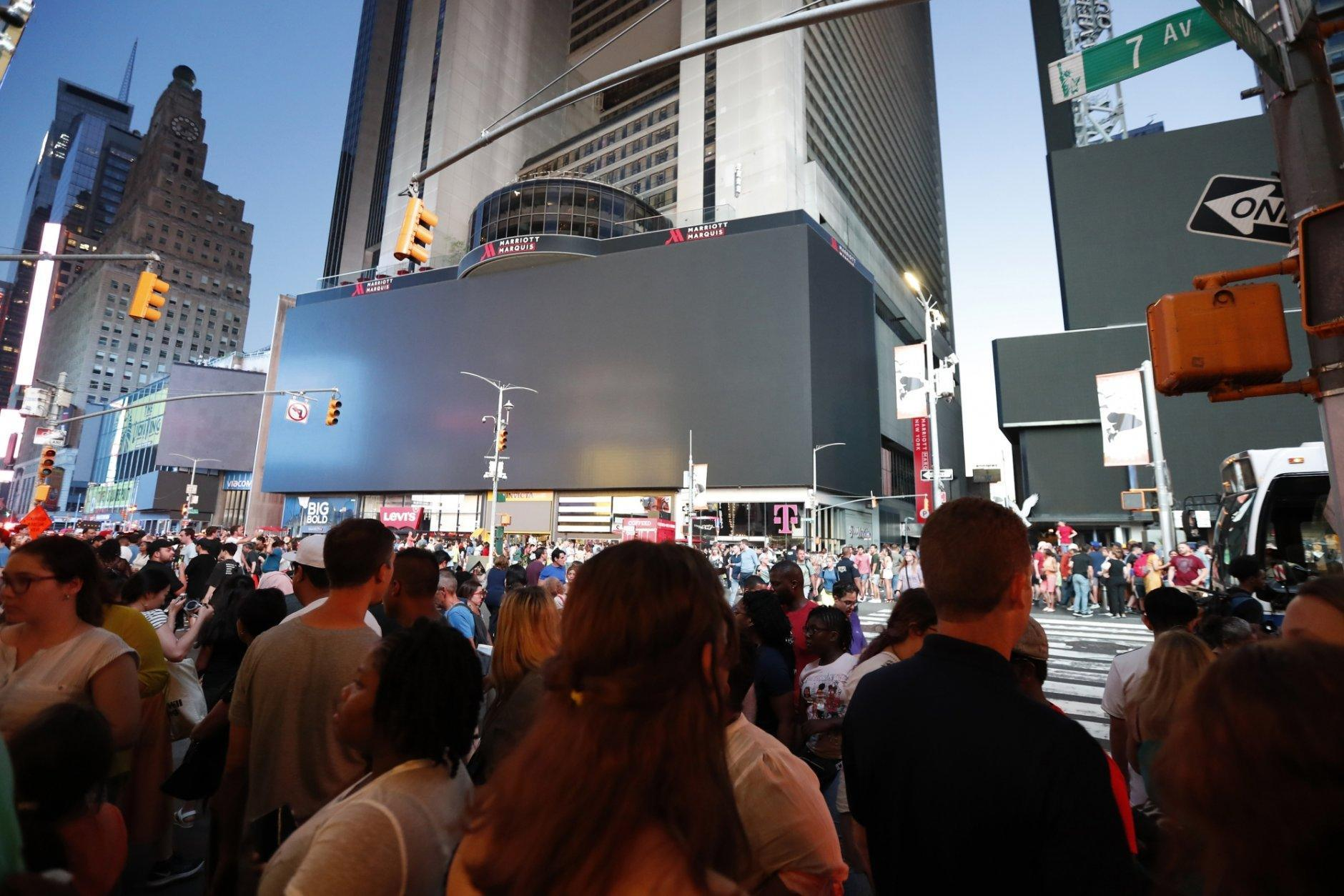 Screens in Time Square are black during a widespread power outage, Saturday, July 13, 2019, in the Manhattan borough of New York. Authorities say a transformer fire caused a power outage in Manhattan and left businesses without electricity, elevators stuck and subway cars stalled. (AP Photo/Michael Owens)
