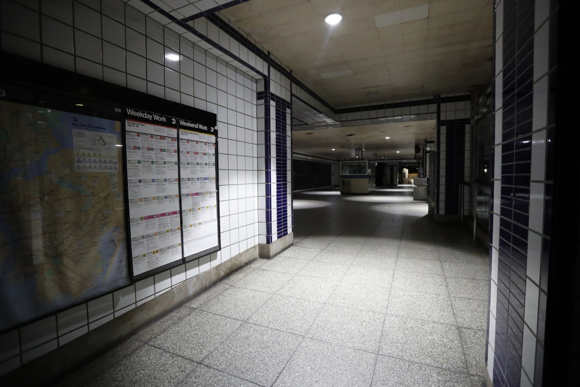 A subway station with emergency lighting is in the dark during a widespread power outage, Saturday, July 13, 2019, in New York. Authorities were scrambling to restore electricity to Manhattan following a power outage that knocked out Times Square's towering electronic screens, darkened marquees in the theater district and left businesses without electricity, elevators stuck and subway cars stalled. (AP Photo/Michael Owens)
