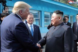 """In this Sunday, June 30, 2019, photo provided by the North Korean government, North Korean leader Kim Jong Un, right, bids farewell to U.S. President Donald Trump, left, and South Korean President Moon Jae-in, at the border village of Panmunjom in Demilitarized Zone. The content of this image is as provided and cannot be independently verified. Korean language watermark on image as provided by source reads: """"KCNA"""" which is the abbreviation for Korean Central News Agency. (Korean Central News Agency/Korea News Service via AP)"""
