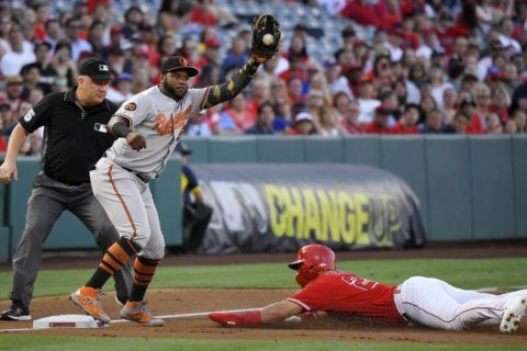 Villar homers in 16th, OF saves Orioles' 10-8 win over Halos