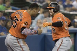 Baltimore Orioles' Renato Nunez, right, celebrates his two-run home run against the Toronto Blue Jays with teammate Anthony Santander in the fourth inning of a baseball game in Toronto, Saturday, July 6, 2019. (Fred Thornhill/The Canadian Press via AP)