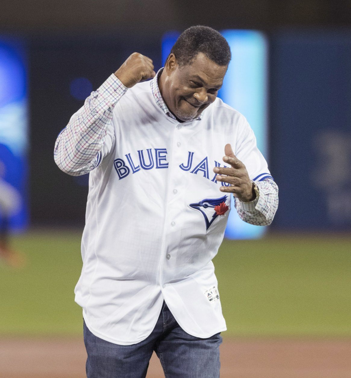 Former Toronto Blue Jays George Bell reacts after throwing out a ceremonial first pitch before the team's baseball game against the Baltimore Orioles on Friday, July 5, 2019, in Toronto. (Fred Thornhill/The Canadian Press via AP)