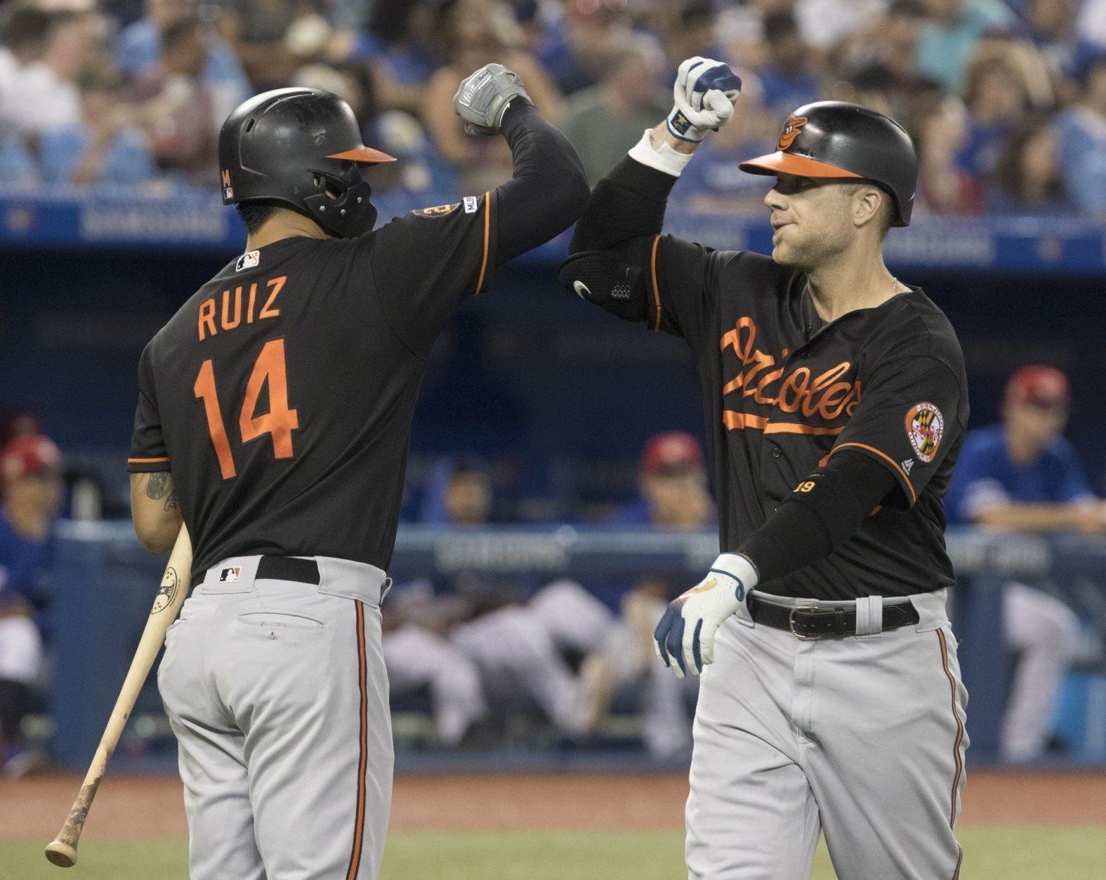 Baltimore Orioles' Chris Davis, right, is greeted by Rio Ruiz after Davis hit a home run against the Toronto Blue Jays during the second inning of a baseball game Friday, July 5, 2019, in Toronto. (Fred Thornhill/The Canadian Press via AP)