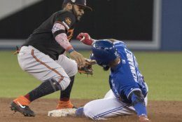 Toronto Blue Jays' Teoscar Hernandez slides safely into second with a double as Baltimore Orioles' Jonathan Villar misses the tag during the third inning of a baseball game Friday, July 5, 2019, in Toronto. (Fred Thornhill/The Canadian Press via AP)