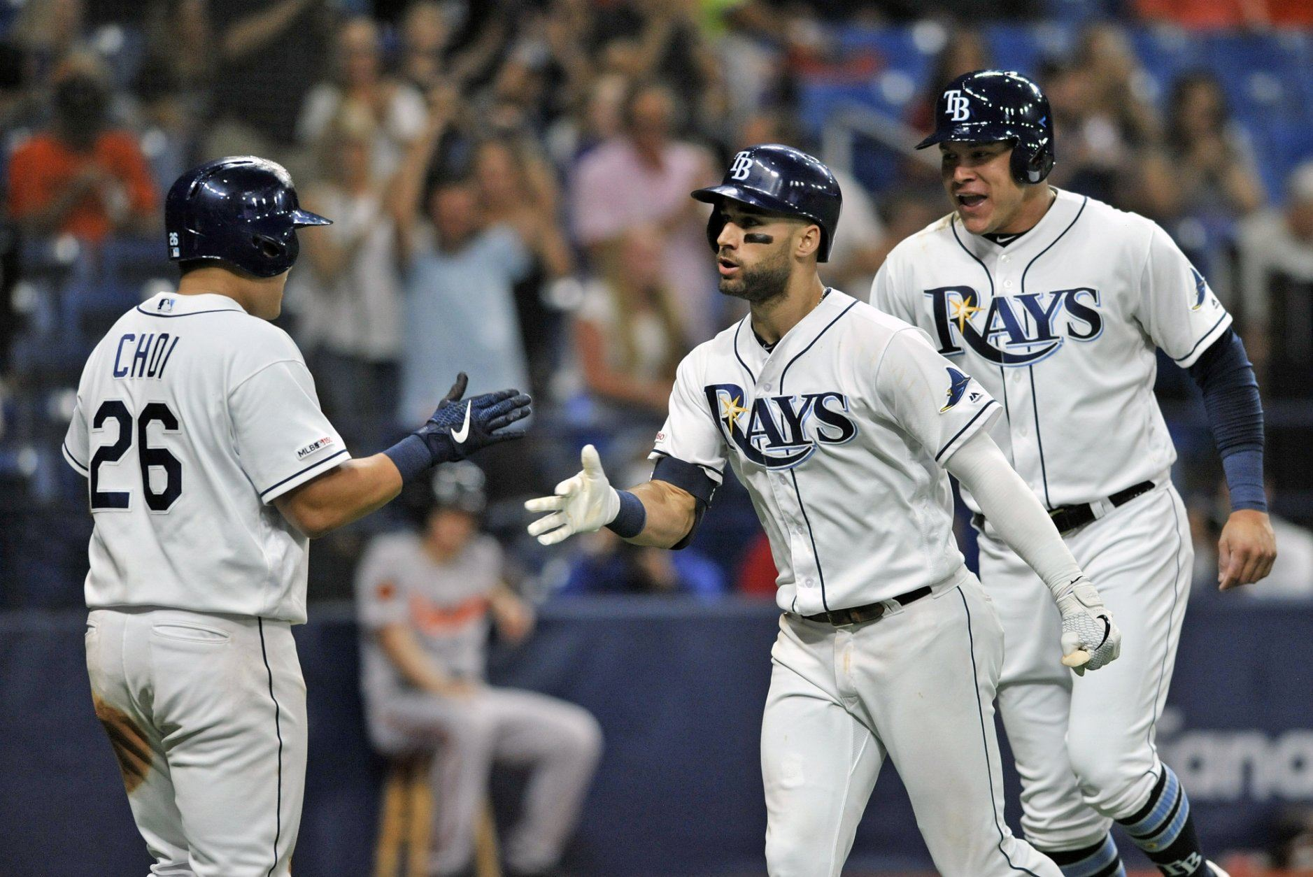 Tampa Bay Rays' Ji-Man Choi (26), Kevin Kiermaier, center, and Avisail Garcia, right, celebrate Kiermaier's three-run home run off Baltimore Orioles reliever Branden Kline during the sixth inning of a baseball game Monday, July 1, 2019, in St. Petersburg, Fla. (AP Photo/Steve Nesius)