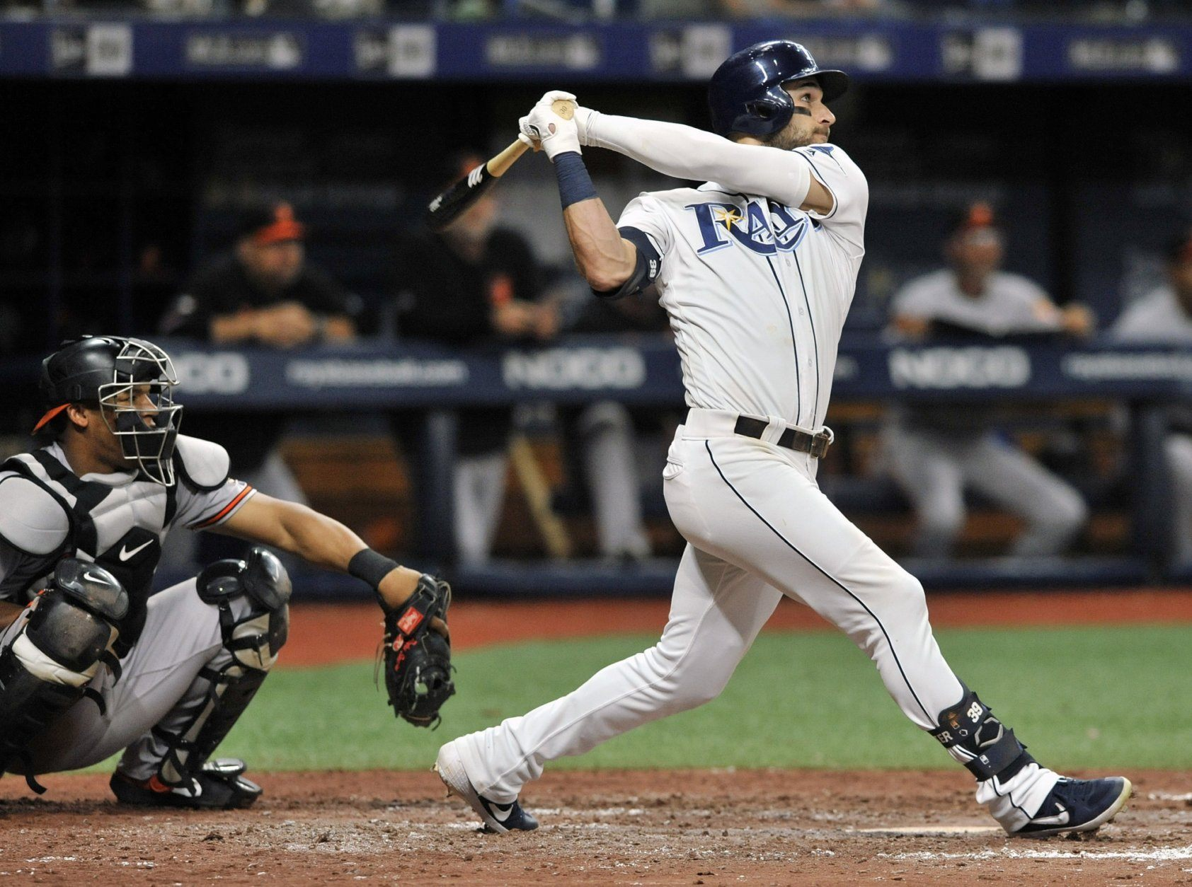 Baltimore Orioles catcher Pedro Severino, left, looks on as Tampa Bay Rays' Kevin Kiermaier hits a three-run home run off Baltimore reliever Branden Kiline during the sixth inning of a baseball game Monday, July 1, 2019, in St. Petersburg, Fla. (AP Photo/Steve Nesius)