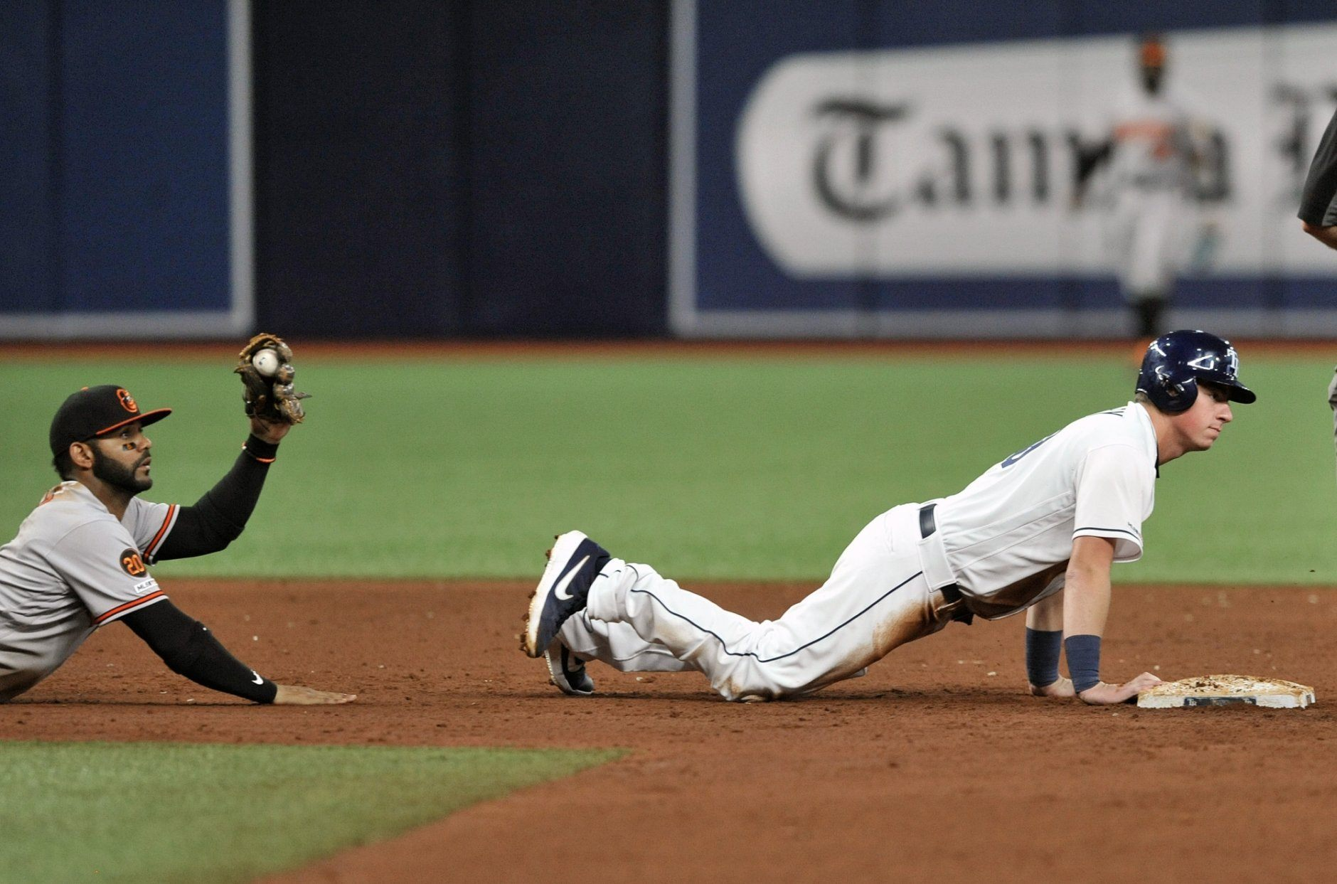 Baltimore Orioles shortstop Jonathan Viillar holds up his glove after tagging out Tampa Bay Rays' Brendan McKay, right, on a pickoff throw from catcher Pedro Severino during the sixth inning of a baseball game Monday, July 1, 2019, in St. Petersburg, Fla. (AP Photo/Steve Nesius)