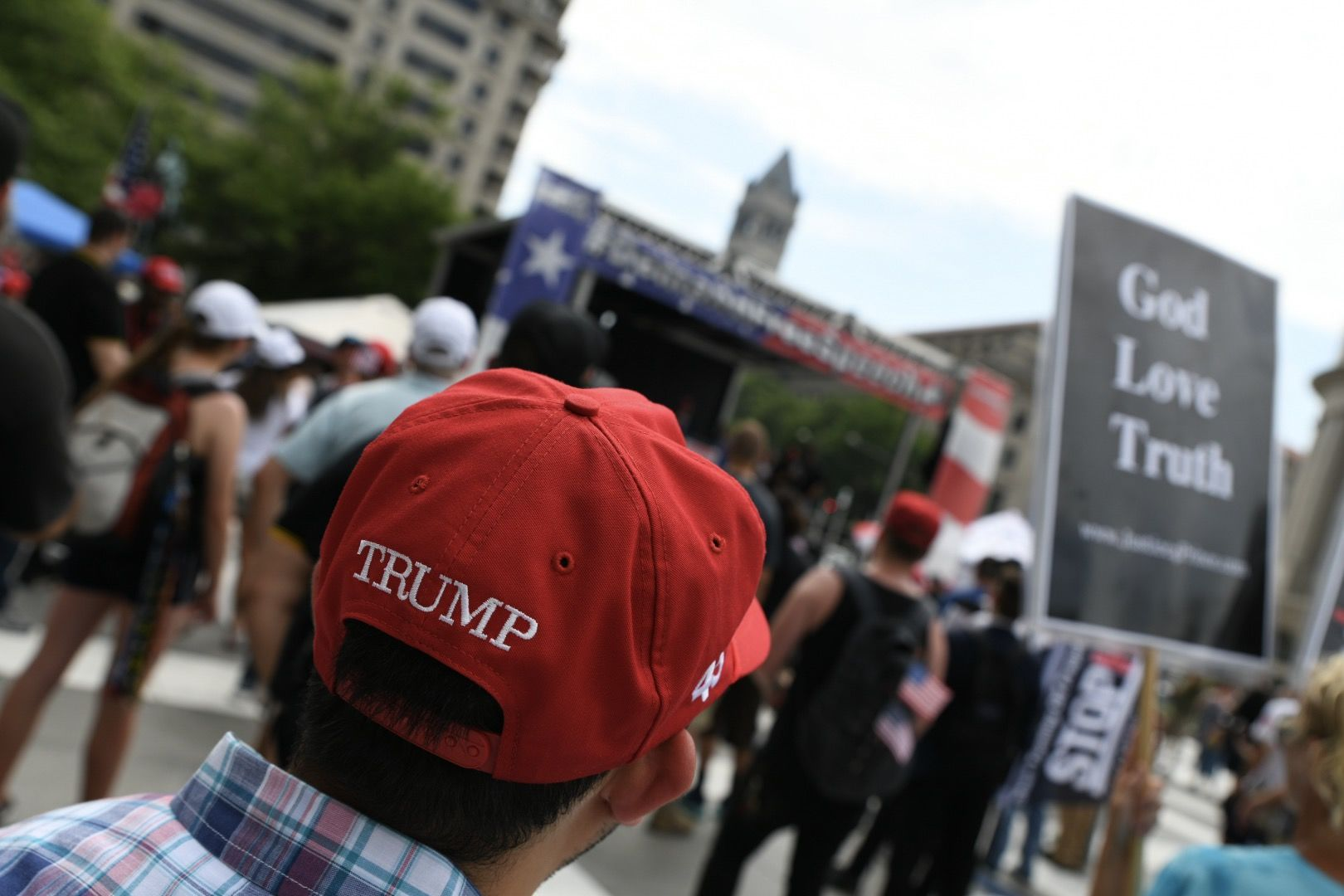 "A supporter of President Donald Trump attends the right-wing ""Demand Free Speech"" rally in Washington D.C.'s Freedom Plaza on July 6, 2019. Trump supporters and anti-fascist organizers held dueling rallies across the street from each other, leading to high tensions as D.C. and U.S. Park Police largely held the peace. (WTOP/Alejandro Alvarez)"