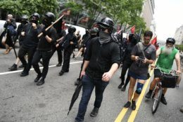 Far-left antifa protesters march down Washington, D.C.'s F Street on July 6, 2019, in an attempt to disrupt a far-right rally in Freedom Plaza. Trump supporters and anti-fascist organizers held dueling rallies across the street from each other, leading to high tensions as D.C. and U.S. Park Police largely held the peace. (WTOP/Alejandro Alvarez)