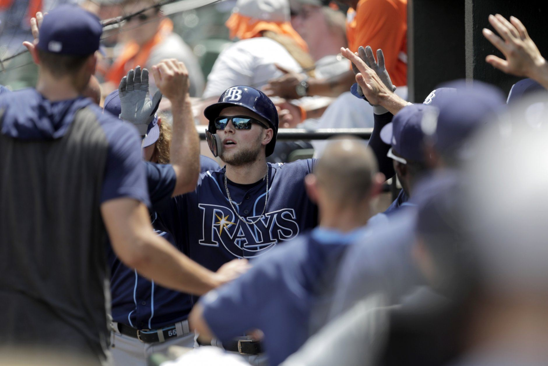 Tampa Bay Rays' Austin Meadows is greeted in the dugout after hitting a solo home run off Baltimore Orioles starting pitcher Thomas Eshelman during the third inning of a baseball game, Sunday, July 14, 2019, in Baltimore. (AP Photo/Julio Cortez)
