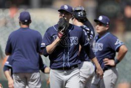 Tampa Bay Rays relief pitcher Ryan Yarbrough is pulled from a baseball game during the ninth inning against the Baltimore Orioles, Sunday, July 14, 2019, in Baltimore. Yarbrough and starting pitcher Ryne Stanek had a combined perfect game through eight innings until Orioles' Hanser Alberto singled off Yarbrough in the ninth. (AP Photo/Julio Cortez)