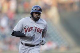 Boston Red Sox's Jackie Bradley Jr. runs the bases after hitting a three run home run off Baltimore Orioles starting pitcher Thomas Eshelman during the second inning of a baseball game, Saturday, July 20, 2019, in Baltimore. (AP Photo/Julio Cortez)