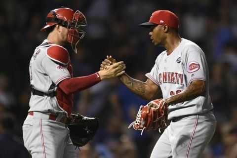 Suárez, Puig homer, Reds jump on Cubs errors to win 6-3