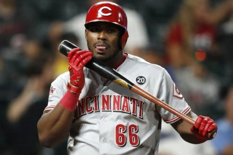 Ervin ties Reds' record with 6 hits in 17-9 win over Rockies