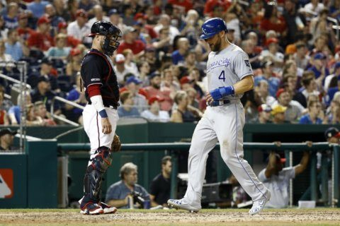 Royals score 3 in 11th inning to outlast Nationals 7-4