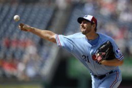 Washington Nationals starting pitcher Max Scherzer delivers during the first inning of a baseball game against the Kansas City Royals, Saturday, July 6, 2019, in Washington. The Nationals are paying tribute to the Montreal Expos in Saturday's game by wearing throwback uniforms. (AP Photo/Nick Wass)