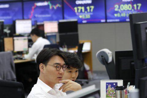 World shares mixed as China reports economic slowdown