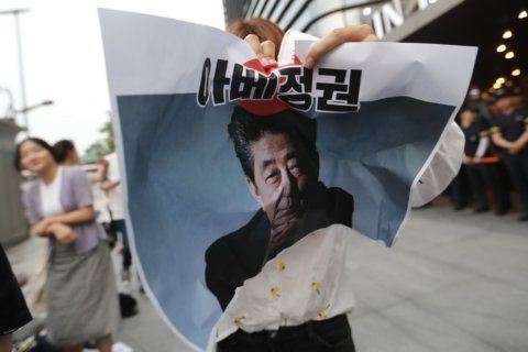 The Latest: S. Korean man dies of burns near Japan Embassy
