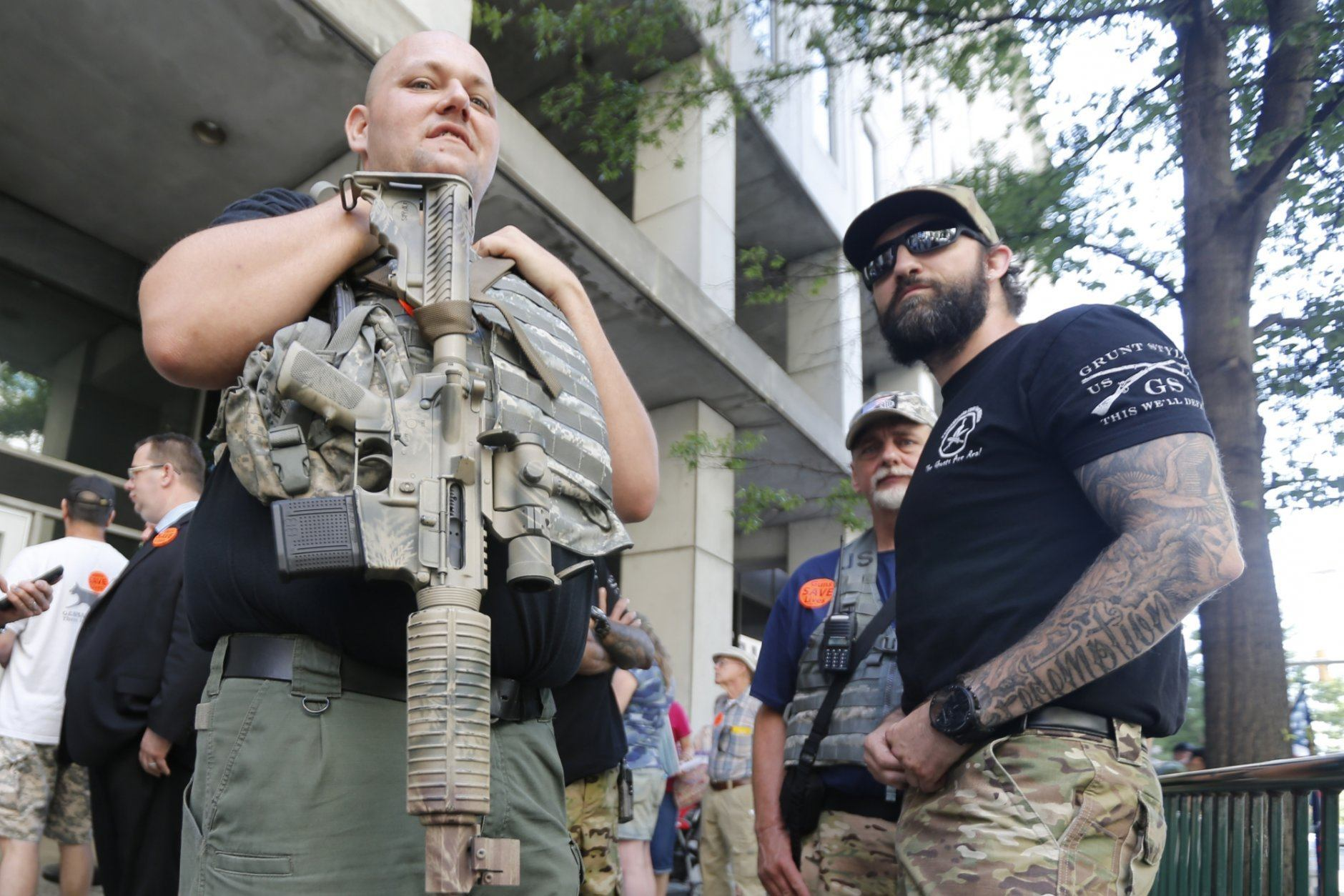 Gun rights supporters hold weapons outside the Capitol office building at the State Capitol in Richmond, Va., Tuesday, July 9, 2019. Governor Northam called a special session of the General Assembly to consider gun legislation in light of the Virginia Beach Shootings. (AP Photo/Steve Helber)