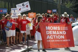 Moms Demanding Action line up during a rally at the State Capitol in Richmond, Va., Tuesday, July 9, 2019. Governor Northam called a special session of the General Assembly to consider gun legislation in light of the Virginia Beach Shootings. (AP Photo/Steve Helber)