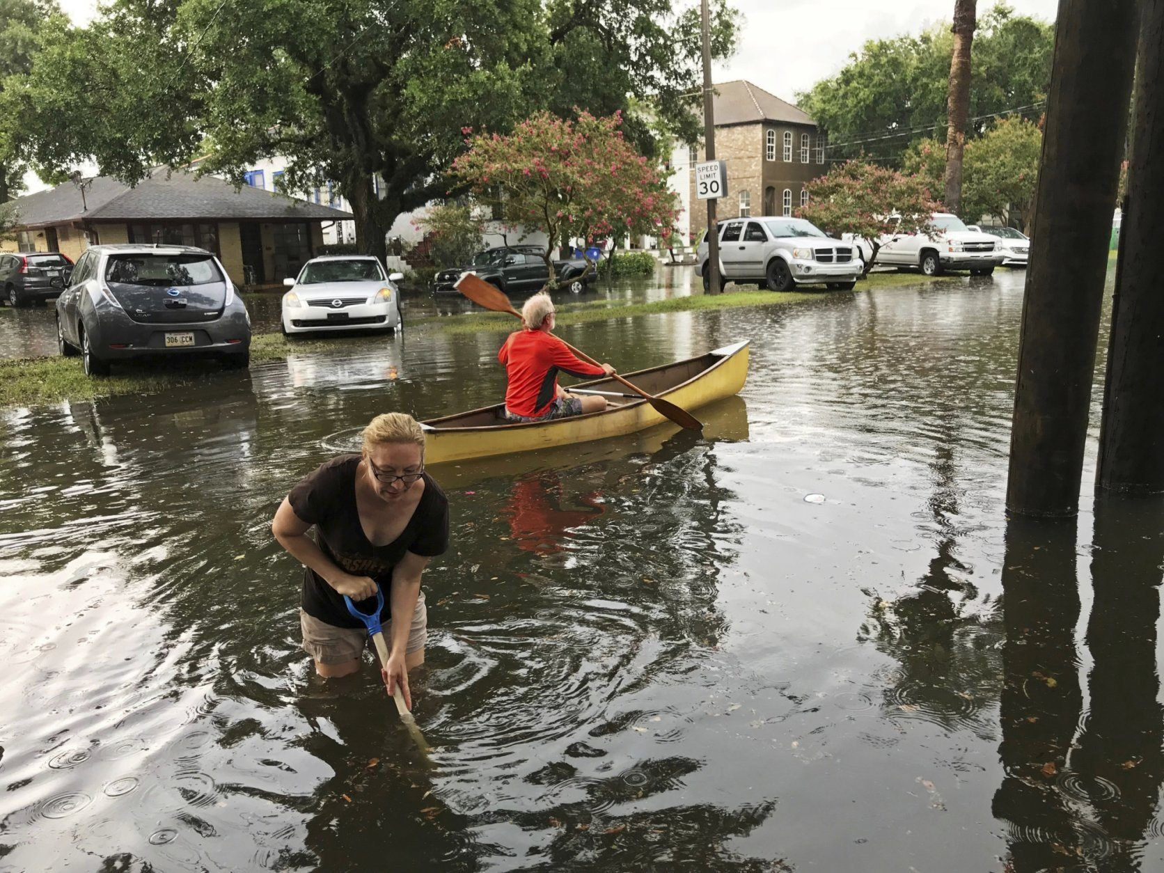 People cope with the aftermath of severe weather in the Broadmoor neighborhood in New Orleans, Wednesday, July 10, 2019.  (Nick Reimann/The Advocate via AP)