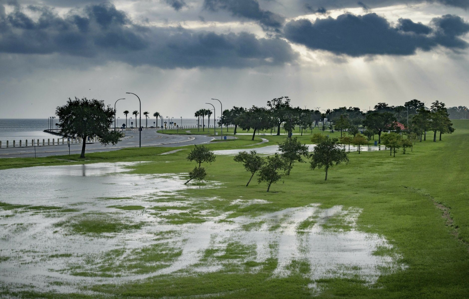 The sky is cloudy as over Lake Pontchartrain on Lakeshore Drive as little flooding is reported in New Orleans, ahead of Tropical Storm Barry making landfall on Saturday, July 13, 2019.  (AP Photo/Matthew Hinton)