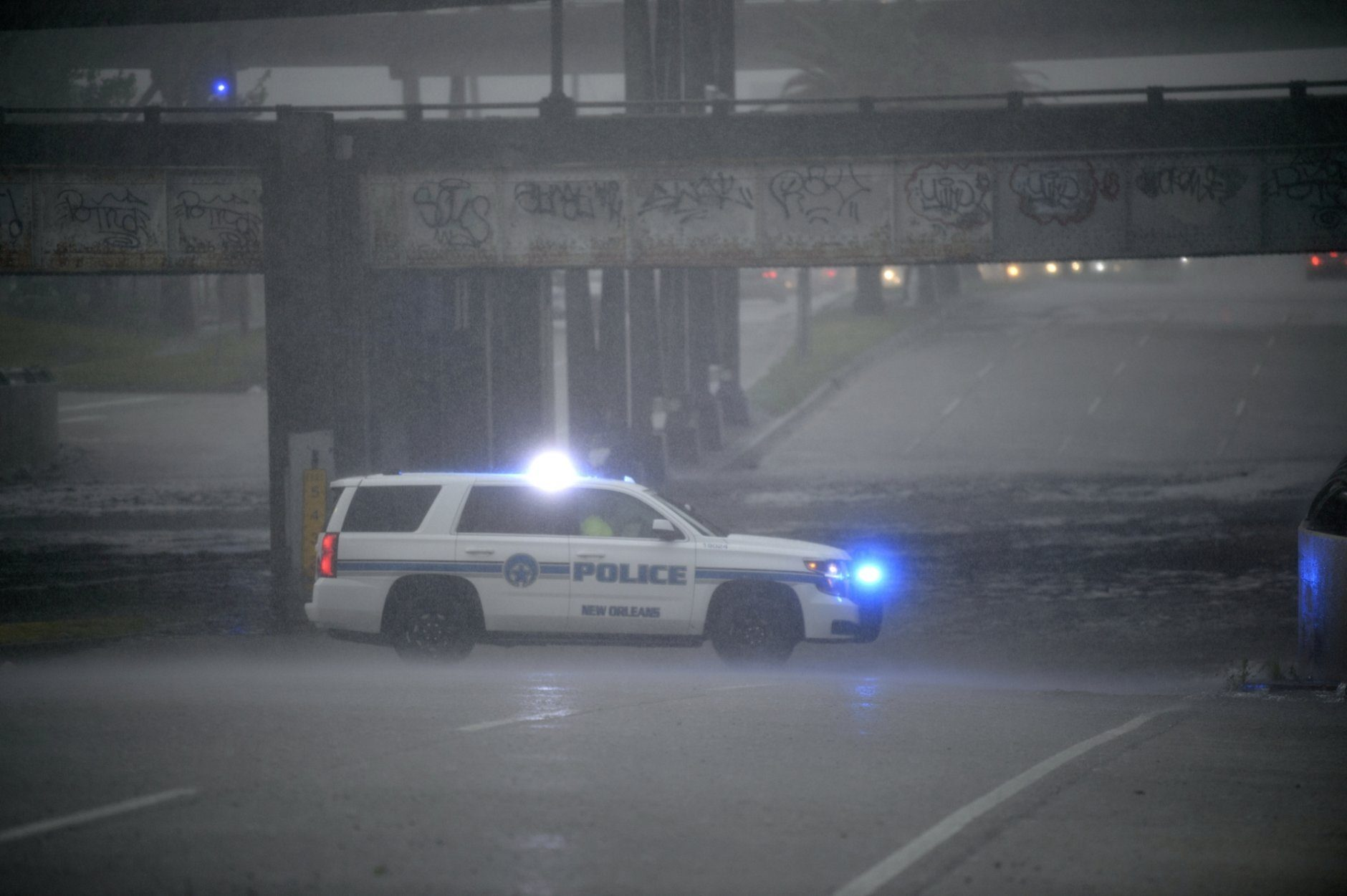 An NOPD cruiser blocks the underpass at S. Carrollton Ave. in New Orleans as severe thunderstorms caused street flooding, Wednesday, July 10, 2019.  (Max Becherer/The Advocate via AP)