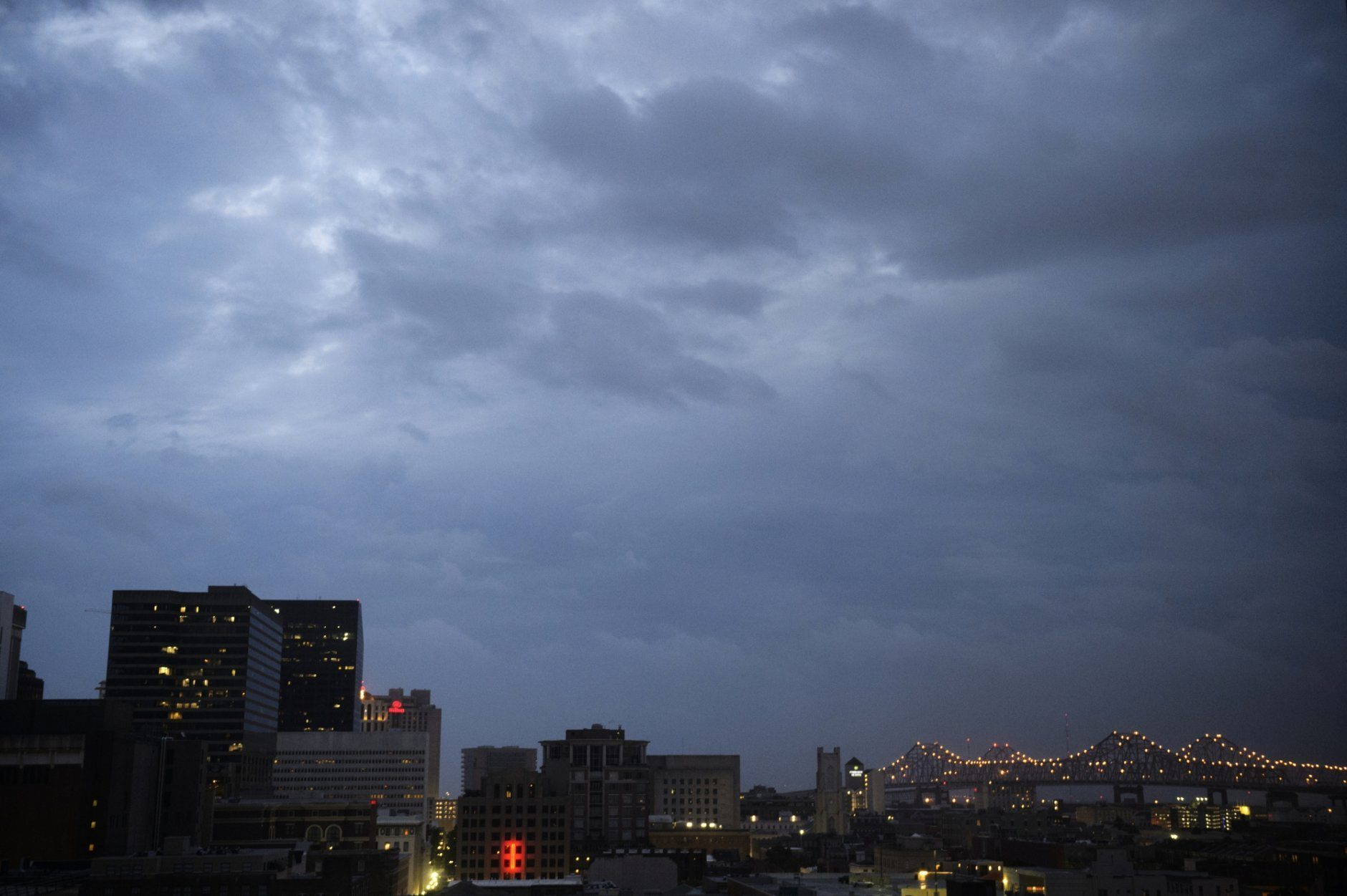 Clouds are seen over the Central Business District at dawn as Tropical Storm Barry approaches in New Orleans Saturday, July 13, 2019. (Max Becherer/The Advocate via AP)