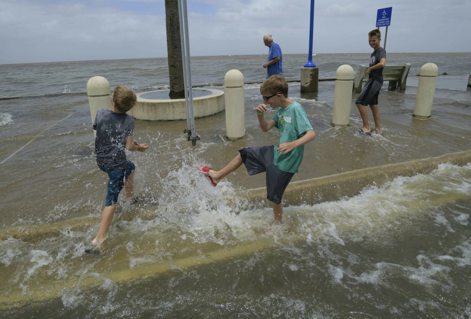 Two kids play in storm surge in New Orleans