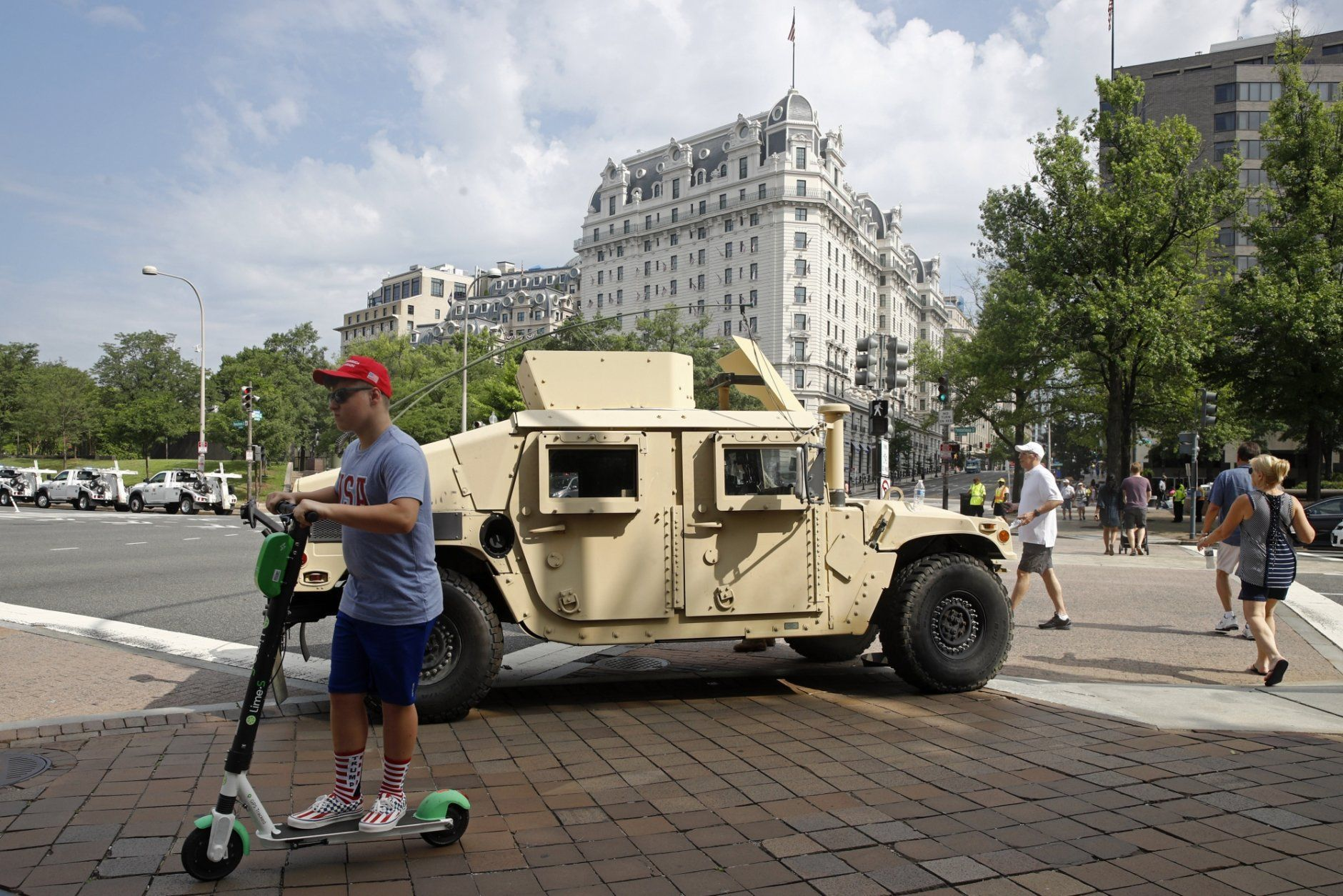 A National Guard vehicle sits parked at a security perimeter near the National Mall in Washington before Independence Day celebrations, Thursday, July 4, 2019. (AP Photo/Patrick Semansky)