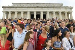People wait for President Donald Trump to speak at an Independence Day celebration in front of the Lincoln Memorial in Washington, Thursday, July 4, 2019. (AP Photo/Susan Walsh, Pool)