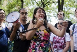 New York State Sen. Jessica Ramos, D-Queens, speaks before the start of a march in opposition to the Trump administration's plans to continue with raids to catch immigrants in the country illegally, Sunday, July 14, 2019, in the Queens borough of New York. (AP Photo/Julius Constantine Motal)