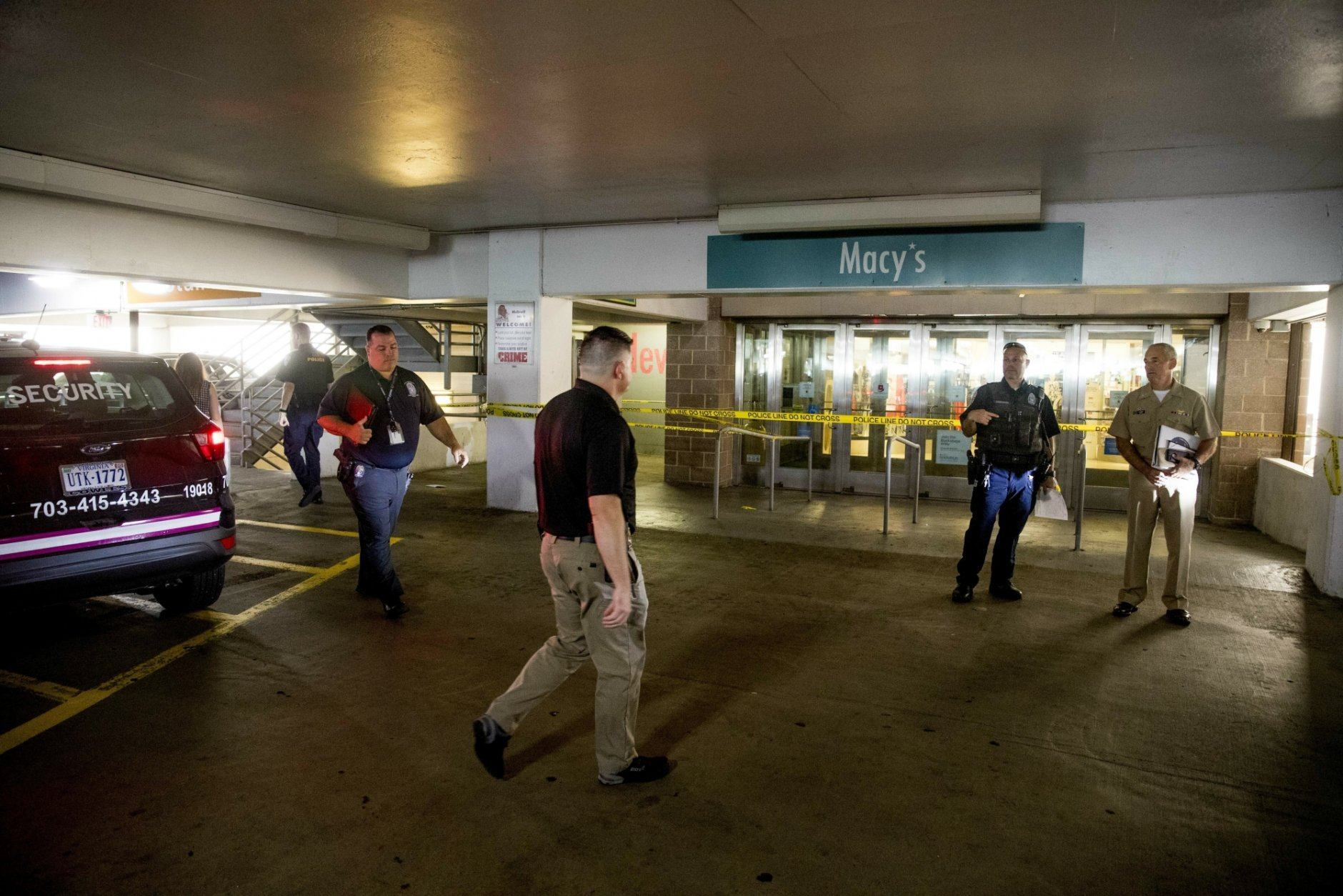 Police work a crime scene following a shooting at the parking garage for the Fashion Centre at Pentagon City, also known as Pentagon City Mall, Monday, July 1, 2019, in Arlington. (AP Photo/Andrew Harnik)