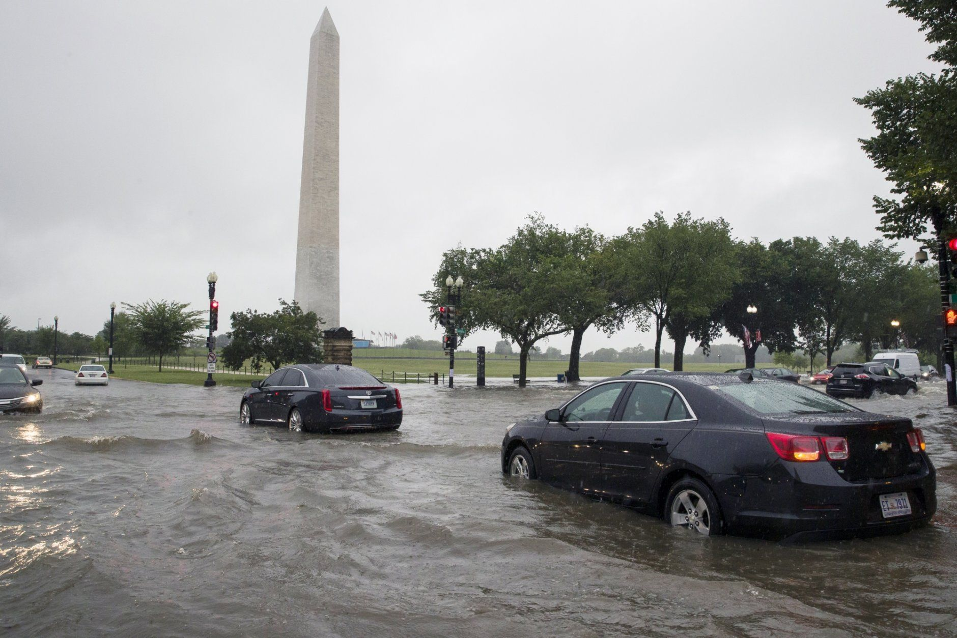 Heavy rainfall flooded the intersection of 15th Street and Constitution Ave., NW stalling cars in the street, Monday, July 8, 2019, in Washington near the Washington Monument. (AP/Alex Brandon)